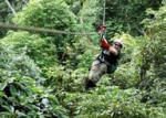 Zipline adventure flying through the jungle canopy